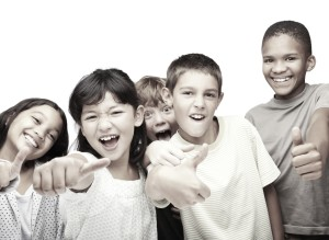 Young children making signs in joy against white background