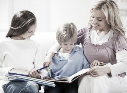 Mother helping children with their homework.